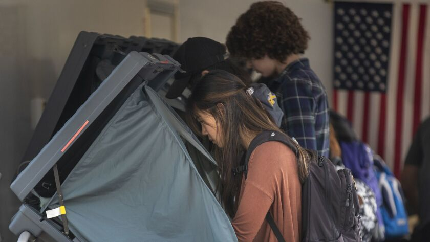 Voters cast ballots early on the campus of UC Irvine.