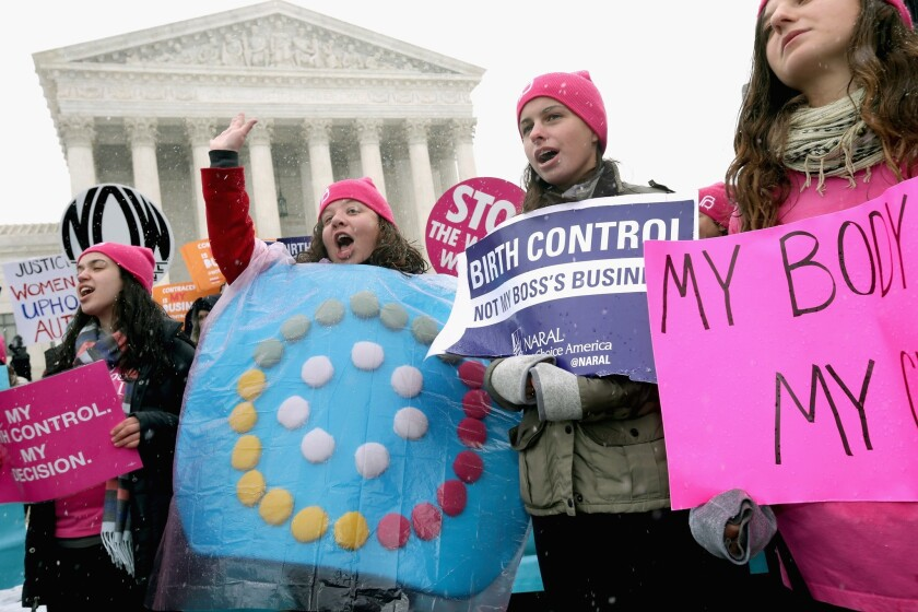Demonstrators rally outside the U.S. Supreme Court in 2014 during oral arguments in the Hobby Lobby case on whether a closely-held for-profit company could refuse to provide health insurance coverage for birth control for its employees.