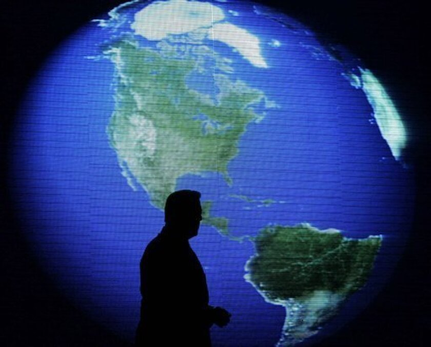 "Former U.S. Vice President and environmentalist Al Gore is silhouetted against an image of the earth during his talk about climate change in Manila, Philippines, Tuesday, June 8, 2010. Gore presented his updated Asian version of ""An Inconvenient Truth"" to his mostly Filipino audience, which includes Philippine President Gloria Macapagal Arroyo. (AP Photo/Aaron Favila)"