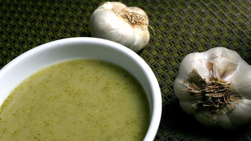 Keep warm with this easy broccoli and roasted garlic soup recipe