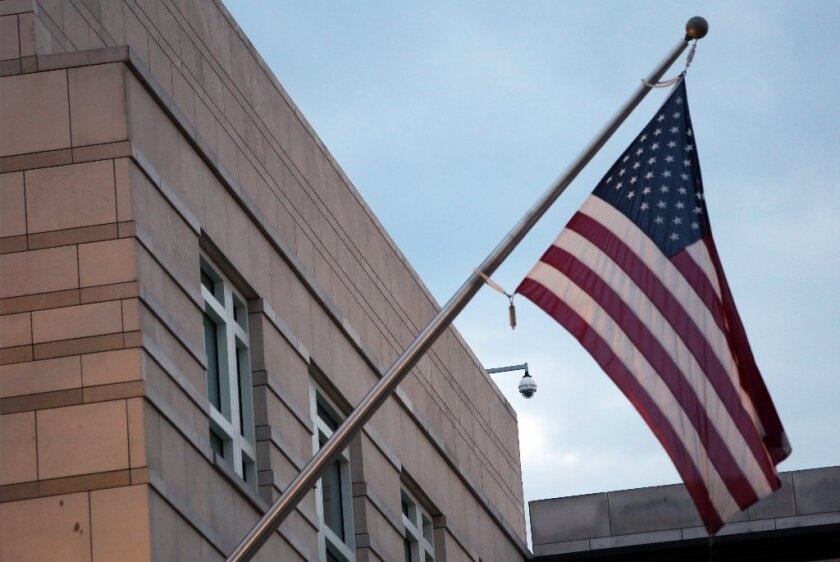 More than 40 U.S. embassies around the world are without ambassadors. Above, an American flag hangs on the U.S. embassy in Berlin.