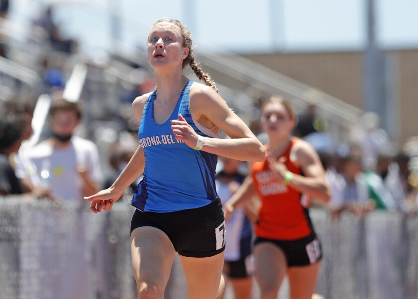 Caroline Glessing of Corona del Mar finishes first  in the girls' 200 meters.