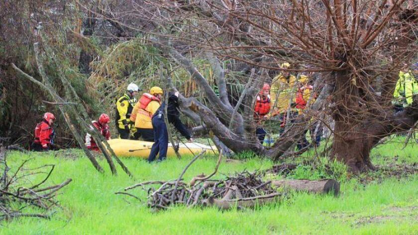 Rescuers recovered the body of a man swept away in his vehicle in Rainbow, Calif.