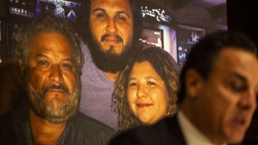LOS ANGELES, CALIF. - NOVEMBER 29: A photograph of Albert Corado, left, and his children, Albert Cor