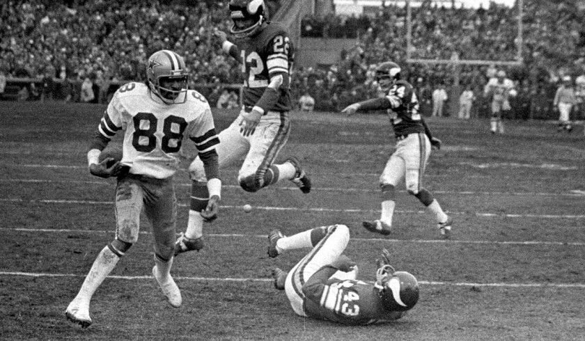 Drew Pearson runs past fallen Vikings cornerback Nate Wright for the winning score in 1975 playoff game.