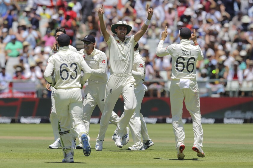 England celebrate the wicket of South Africa's captain Far Du Plessis during day two of the second cricket test between South Africa and England at the Newlands Cricket Stadium in Cape Town, South Africa, Saturday Jan. 4, 2020. (AP Photo/Halden Krog)