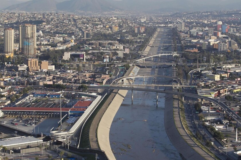 The Tijuana river flows to the U.S. just past the curve on the bottom of the photo.