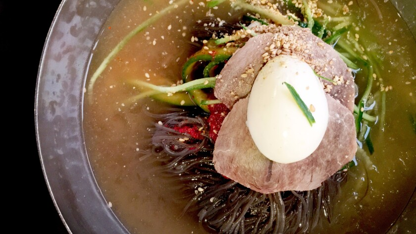 Cool off in Koreatown with Yu Chun's mool chic naengmyun, served so cold that it might just give you a brain freeze.