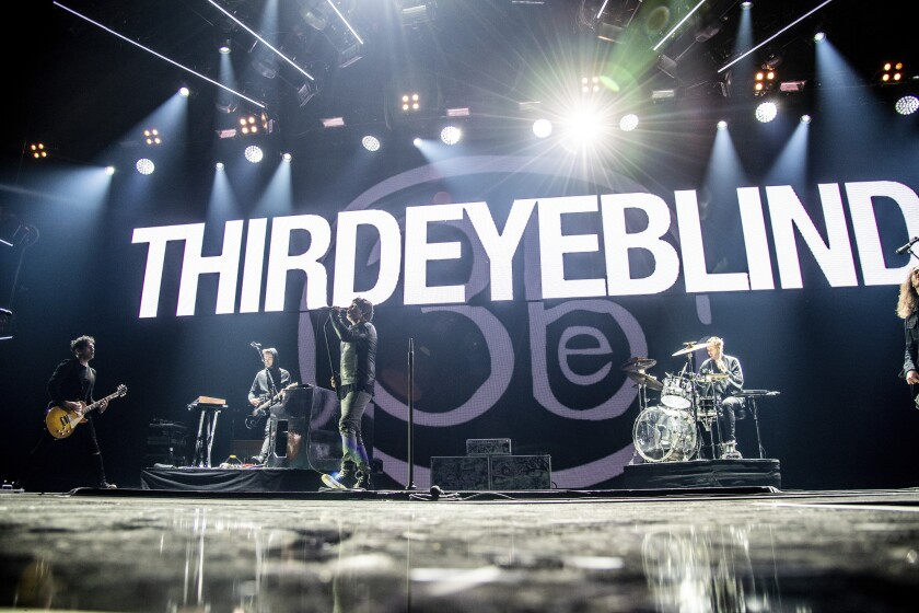 FILE - This Dec. 8, 2018 file photo shows Kryz Reid, from left, Alex Kopp, Stephan Jenkins and Brad Hargreaves of Third Eye Blind performing at the 2018 KROQ Absolut Almost Acoustic Christmas in Inglewood, Calif. Rock band Third Eye Blind pride themselves on never canceling a tour, but with the growing coronavirus, the musicians may have to do something they thought they would never do. (Photo by Amy Harris/Invision/AP, File)