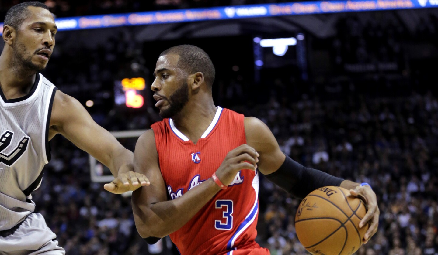 Clippers point guard Chris Paul (3) drives around Spurs forward Boris Diaw during their game Saturday night in San Antonio.