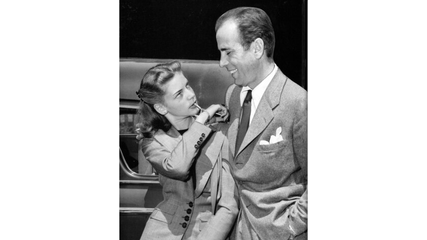May 25, 1945: Humphrey Bogart and Lauren Bacall are seen at Union Station after returning to California after their wedding in Ohio. Bacall is blowing a small whistle attached to her bracelet.