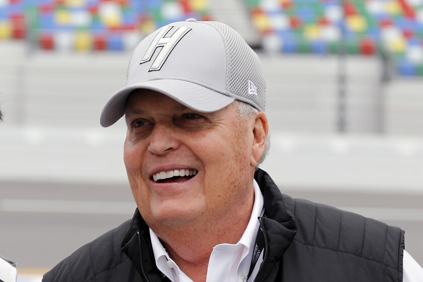 FILE - In this Feb. 10, 2019, file photo, team owner Rick Hendrick laughs on pit road during qualifying for the Daytona 500 auto race at Daytona International Speedway, in Daytona Beach, Fla. Reinstated last week by NASCAR, driver Kyle Larson on Wednesday, Oct. 28, 2020, signed a multi-year contract with Hendrick Motorsports to drive the No. 5 Chevrolet next season. Hendrick has sold no sponsorship as of yet for Larson and only needed the blessing of Chevrolet, one of the partners that originally dropped Larson for using the n-word, to finalize the deal. (AP Photo/Terry Renna, File)