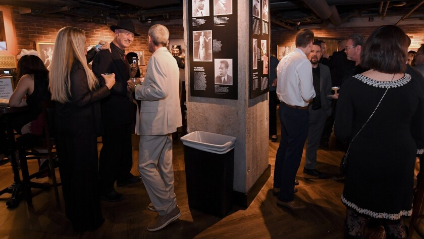Guests mingle during the unveiling of the Mob Museum's distillery and speakeasy, The Underground, Th