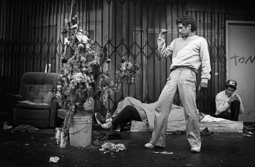 Dec. 1988: Ernesto (Angel) Perez, 31, reacts after decorating a tree that he and homeless friends se