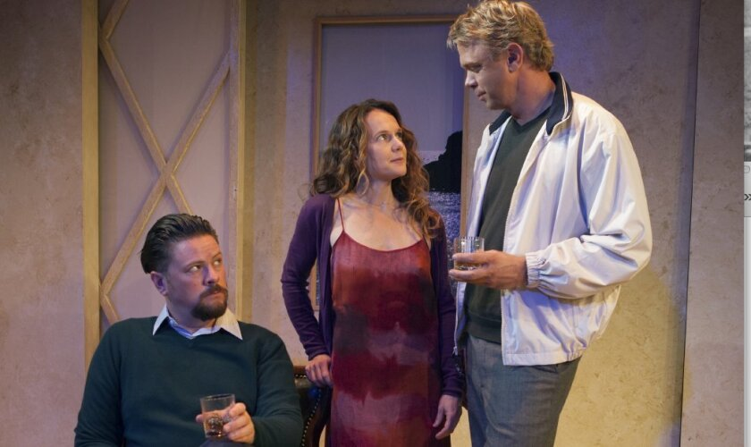 Robert (Richard Baird) gives the evil eye to friend Jerry (Jeffrey Fracé) over attentions to his wife, Emma (Carla Harting), in Harold Pinter's 'Betrayal' at North Coast Repertory Theatre.