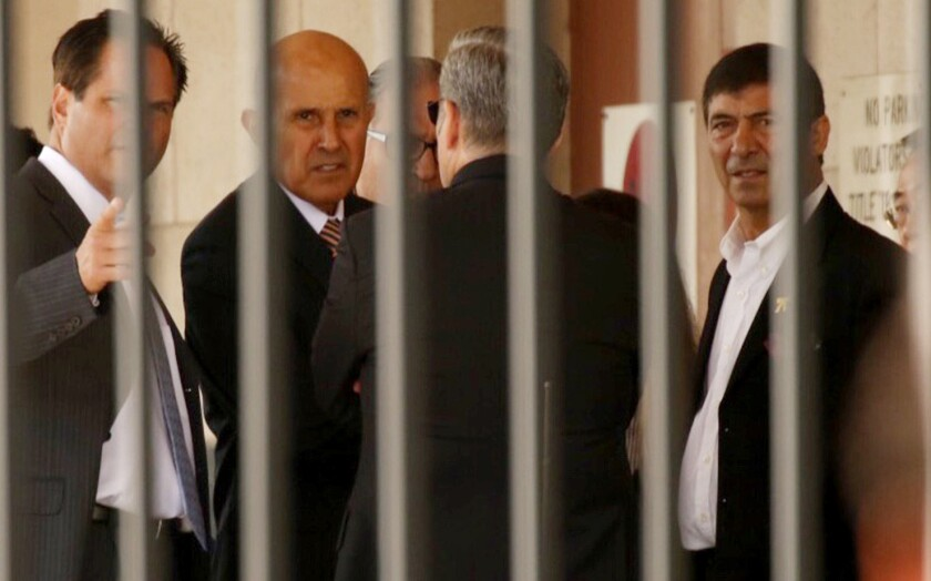 Former Los Angeles County Sheriff Lee Baca leaves federal court via a loading dock Monday.