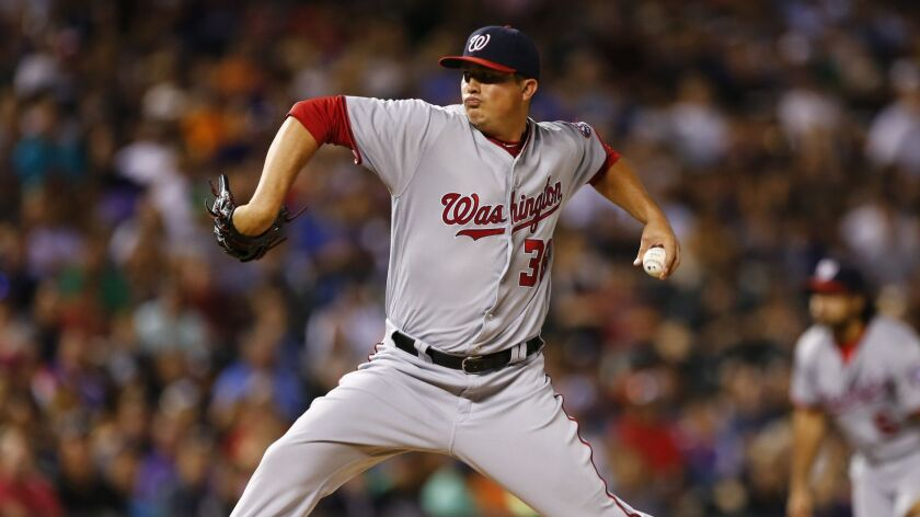 Sammy Solis pitches for the Nationals in 2016, The Padres signed the left-hander to a minor-league deal
