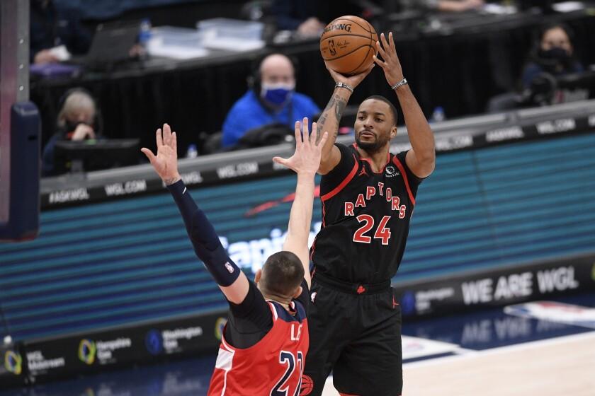 Toronto Raptors guard Norman Powell (24) shoots against Washington Wizards center Alex Len (27) during the second half of an NBA basketball game, Wednesday, Feb. 10, 2021, in Washington. (AP Photo/Nick Wass)