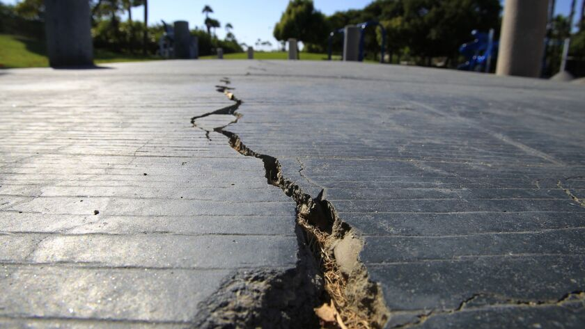 A long crack splits the sidewalk at the Discovery Well Park in Huntington Beach, located on top of the Newport-Inglewood fault.