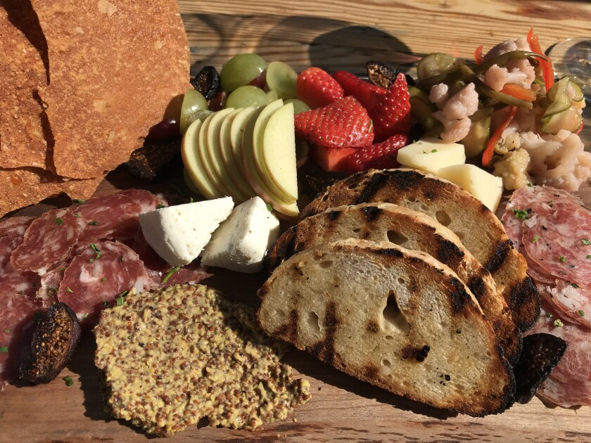 The happy hour charcuterie board at Wheat and Water will leave you happy (and full).