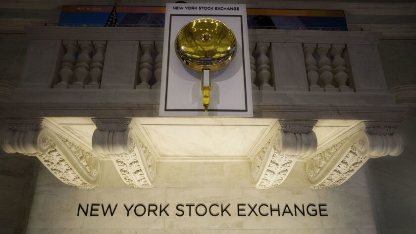 FILE- In this May 10, 2018, file photo the opening bell hangs above the trading floor at the New Yor