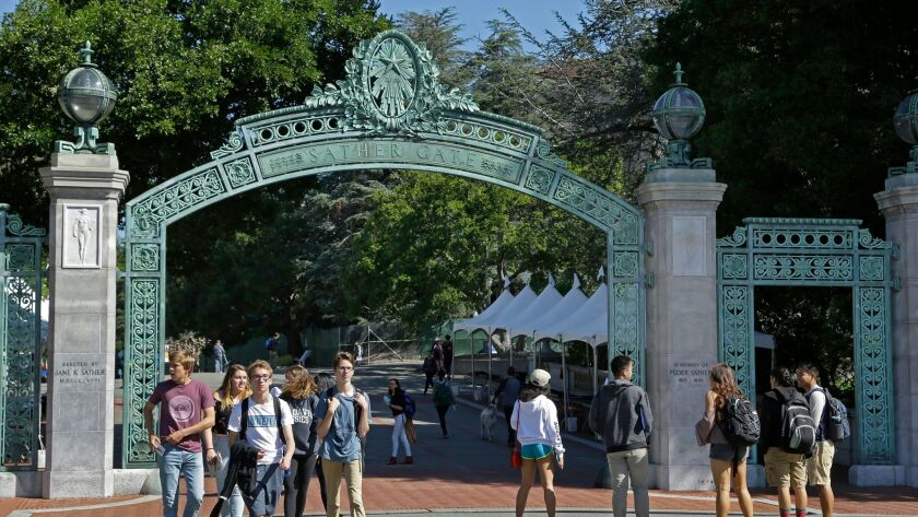 Students walk past Sather Gate on the University of California at Berkeley campus on Friday, April 2