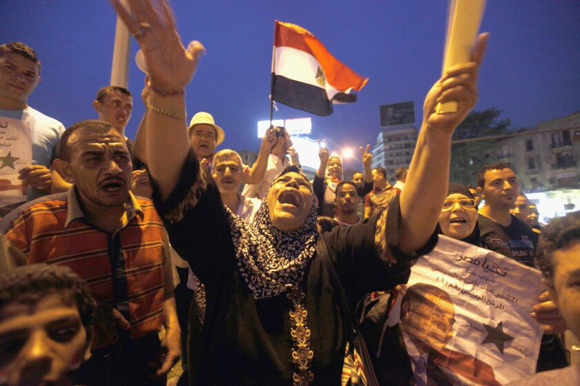 People celebrate the election of former army chief Abdel Fattah Sisi as president of Egypt in Tahrir Square in Cairo.