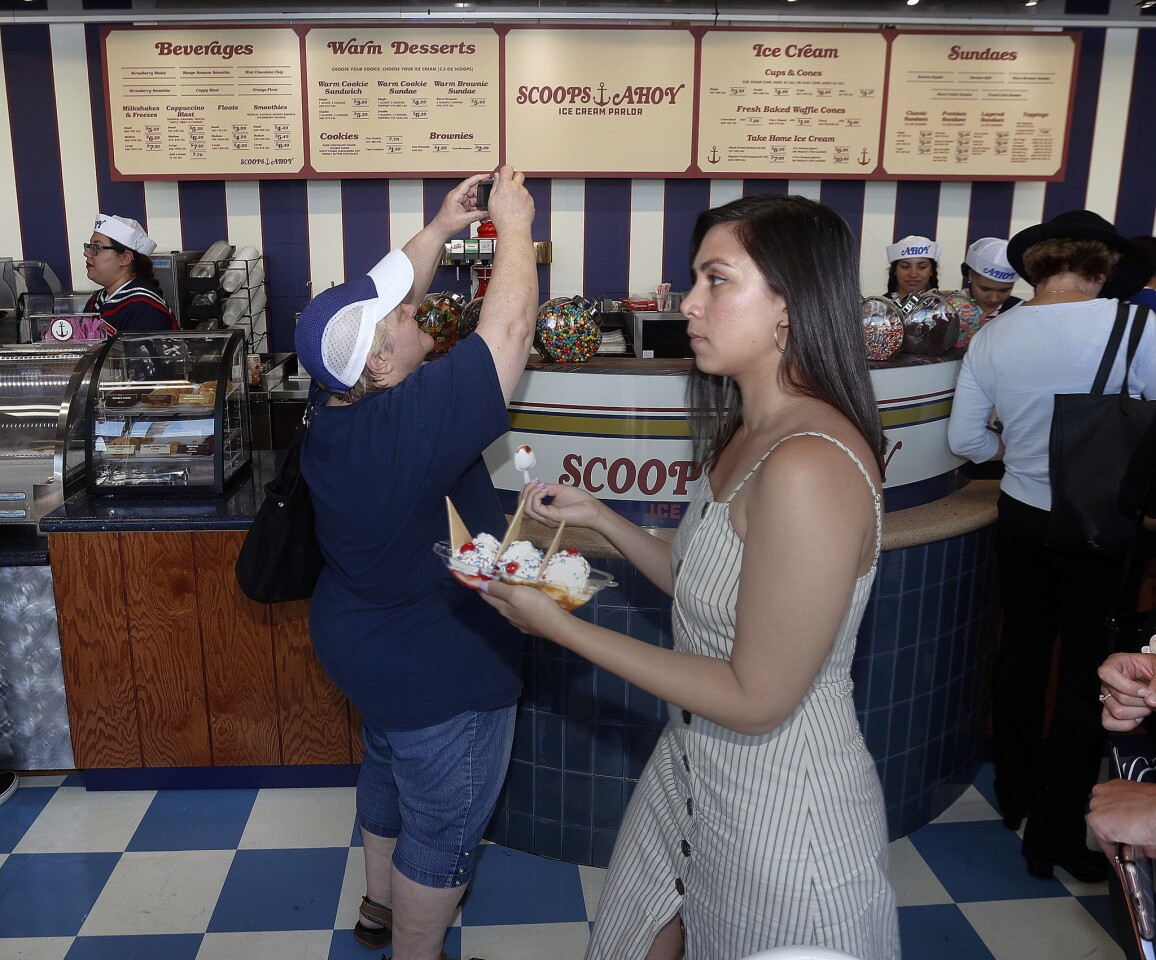 People taking pictures and carrying away serving boats of ice cream at Baskin Robbins, transformed into an 80s-era replica of an ice cream shop called Scoops Ahoy in Burbank on Tuesday, July 2, 2019. Scoops Ahoy Ice Cream Parlor will be featured in the third season of the Netflix program Stranger Things.
