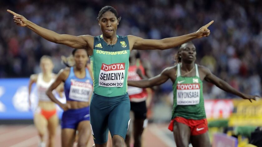 South Africa's Caster Semenya celebrates after winning the gold in the 800 meters at the World Athletics Championships on Aug. 13, 2007.