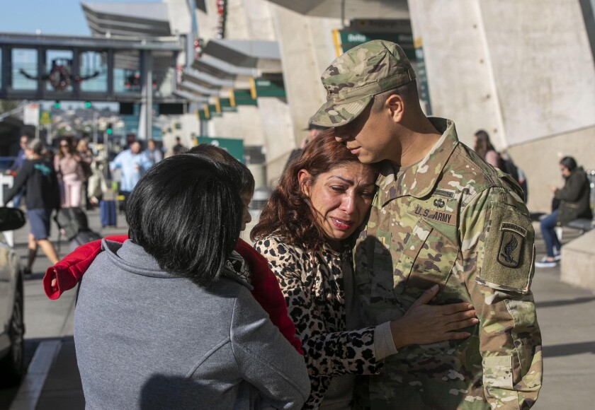 Army 2nd Lt. Gibram Cruz hugs his mother, Rocio Rebollar Gomez, who is scheduled for deportation Jan. 2. This could be the last time Cruz sees her in the United States unless a legislative or administrative miracle comes through.
