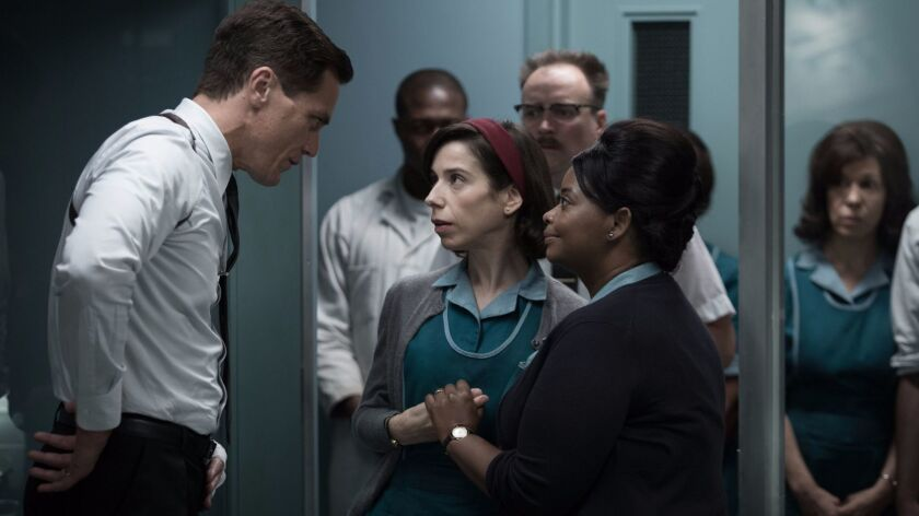 "(L-R) - Michael Shannon, Sally Hawkins and Octavia Spencer in the film ""THE SHAPE OF WATER."" Credit"