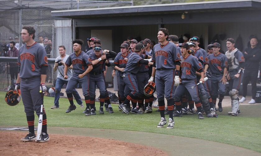 Members of the Huntington Beach baseball team celebrate after Jake Vogel's home run during the CIF q