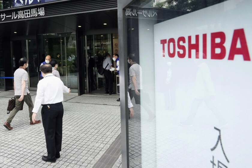 Shareholders arrive for Toshiba's general meeting of shareholders in Tokyo Friday, June 25, 2021. Battered Japanese nuclear and electronics giant Toshiba Corp. faced off with shareholders Friday, seeking to shake off serious questions about governance at the once revered brand. (Katsuya Miyagawa/Kyodo News via AP)