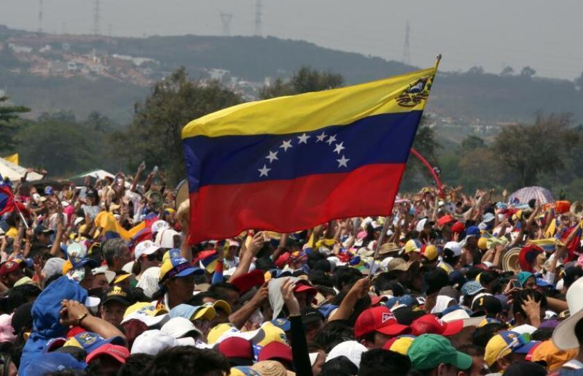 File photo showing a Venezuelan flag displayed at a rally. Florida state lawmakers condemned Venezuela's Nicolas Maduro regime on March 18, 2019, in Tallahassee and called for Temporary Protected Status to be immediately extended to Venezuelans in the US. EFE-EPA/File