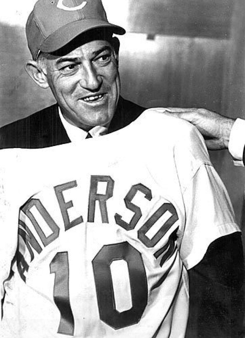 Sparky Anderson holds up his new jersey upon being named manager of the Cincinnati Reds. His Reds won championships in 1975 and '76 as one of the dominant teams of the era. Nearly a decade later, his Detroit Tigers won the 1984 World Series. He was inducted into baseball's Hall of Fame in 2000. See full story