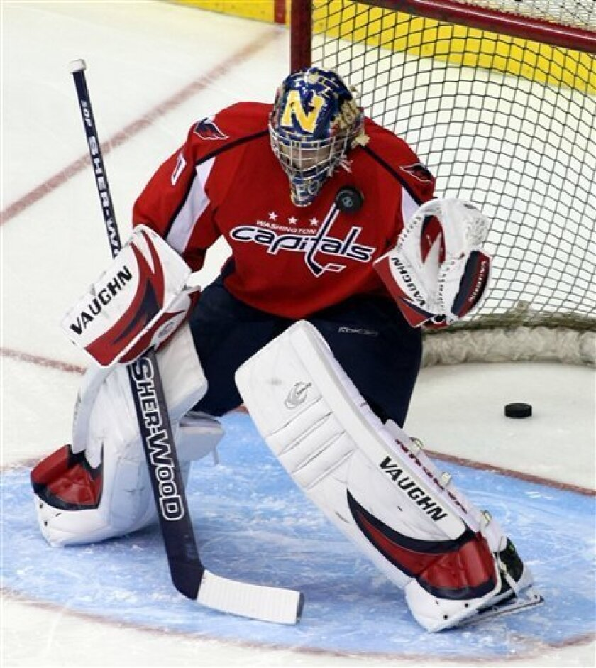Washington Capitals backup goaltender Brett Leonhardt warms-up before an NHL hockey game against Ottawa Senators, Friday, Dec. 12, 2008, in Washington.Leonhardt, a 6-foot-7 Web site producer for the Capitals, dressed as the team's backup goalie for Friday night's game against the Senators because o