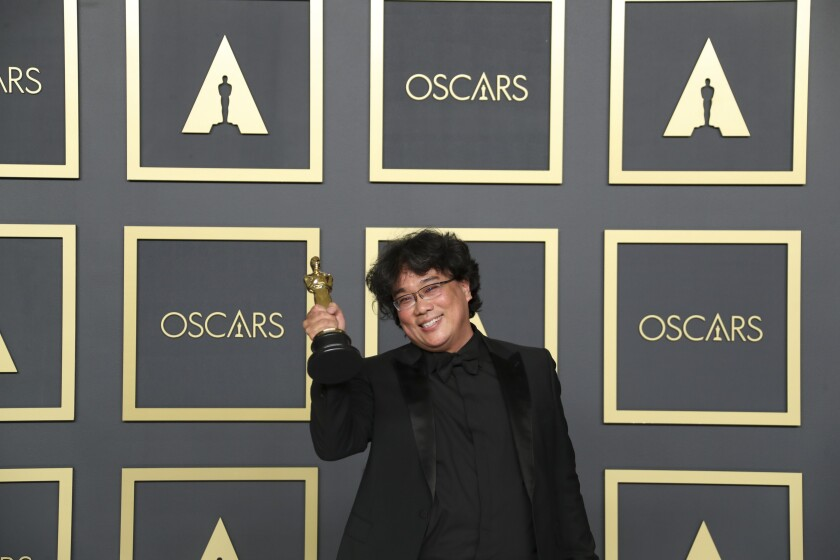 Bong Joon Ho with his 2020 Oscar for best director