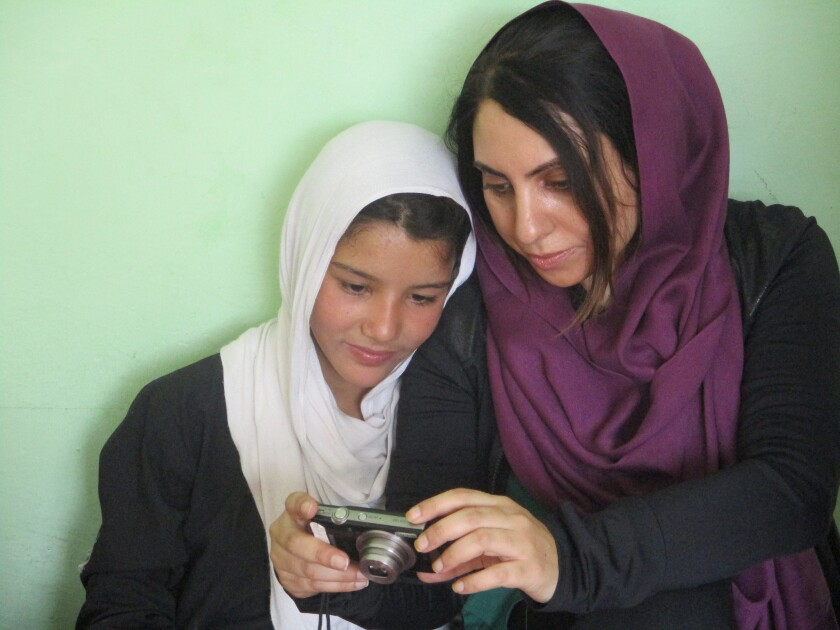 Aria Raofi and her photography student before the bombing in Kabul, Afghanistan.