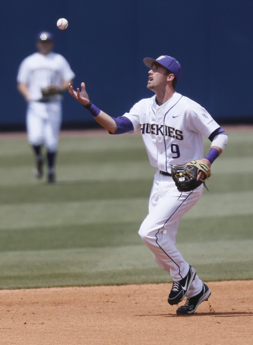 Washington infielder Erik Forgione (9) bobbles a Mississippi hit in the second inning of an NCAA college baseball regional tournament championship game in Oxford, Miss., Monday, June 2, 2014. (AP Photo/Rogelio V. Solis)