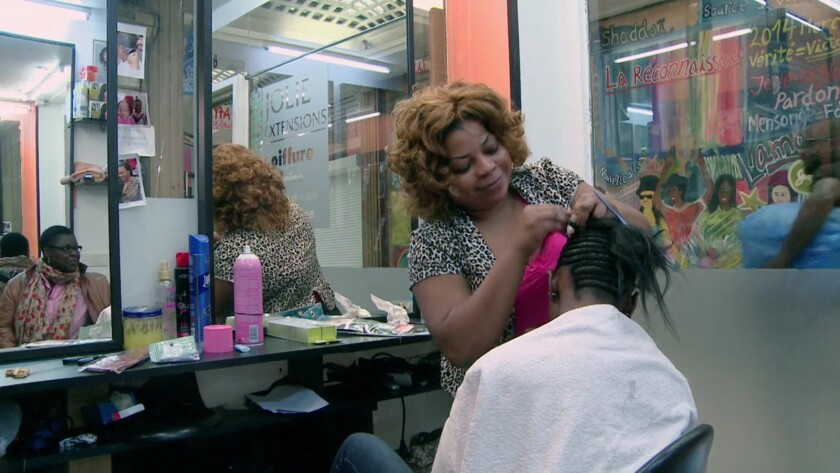 A scene in a hair salon from the documentary 'Chez Jolie Coiffure'