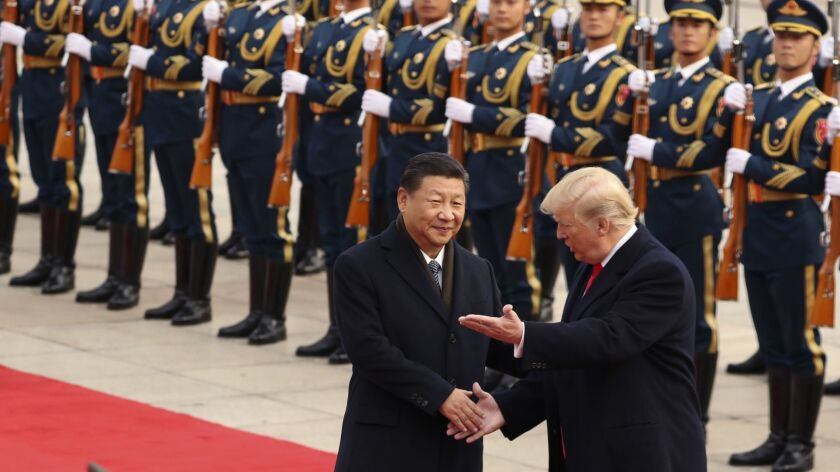 FILE - In this Nov. 9, 2017, file photo, President Donald Trump and Chinese President Xi Jinping par