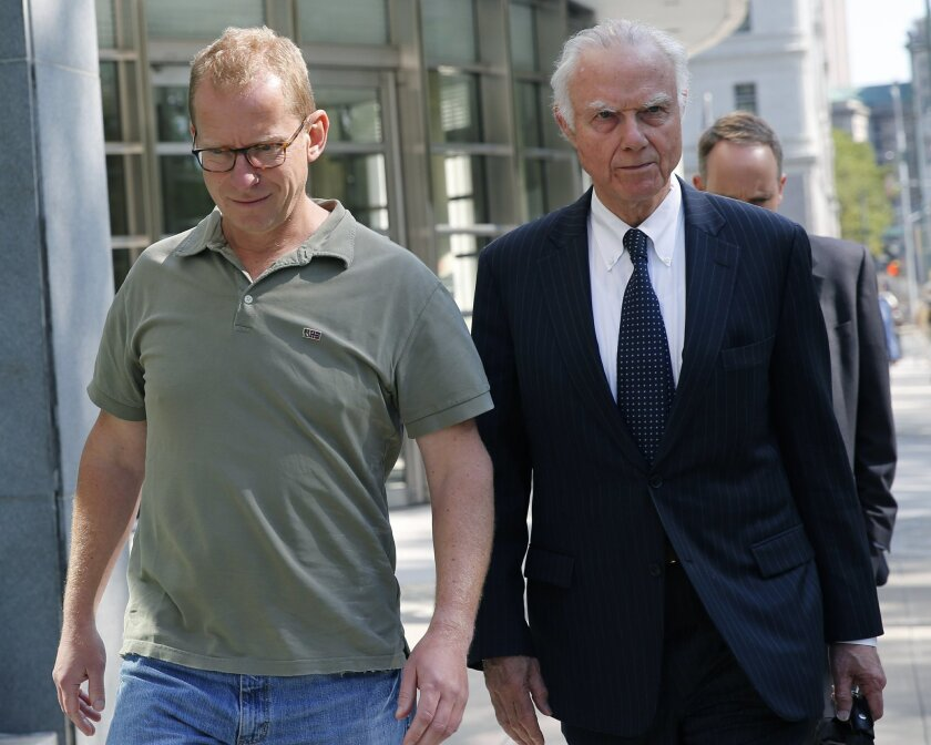 HSBC Bank's head of foreign exchange cash trading Mark Johnson, 50, left, leaves U.S. District Court in Brooklyn with an attorney after posting bail, Wednesday, July 20, 2016, in New York. U.S. Attorney U.S. Attorney Robert Capers says Johnson put personal and company profits ahead of his customers