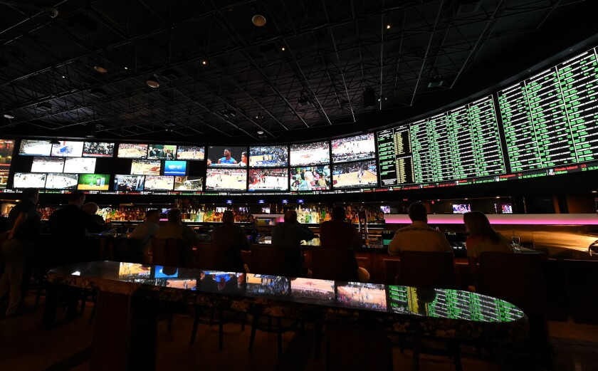 The betting line and some of the nearly 400 proposition bets for Super Bowl 50 are displayed at the Race & Sports SuperBook at the Westgate Las Vegas Resort & Casino on Feb. 2.
