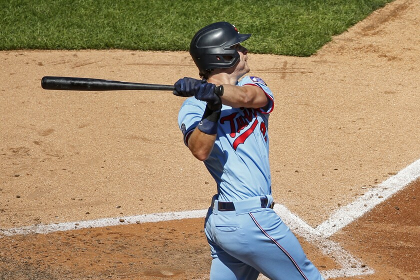 Minnesota Twins' Max Kepler hits a two-run home run against the Kansas City Royals in the fifth inning of a baseball game Sunday, Aug. 16, 2020, in Minneapolis. (AP Photo/Bruce Kluckhohn)