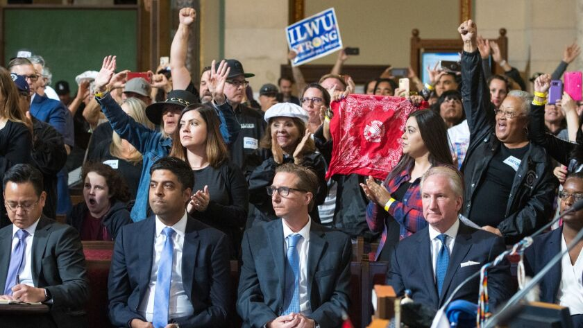 LOS ANGELES, CA - JUNE 28, 2019: Port of L.A. officials sit in the front row as longshoreman support