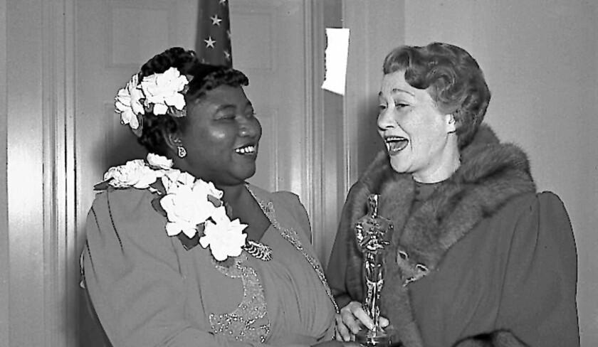 Hattie McDaniel, left, gets an Oscar in 1940 from Fay Bainter.