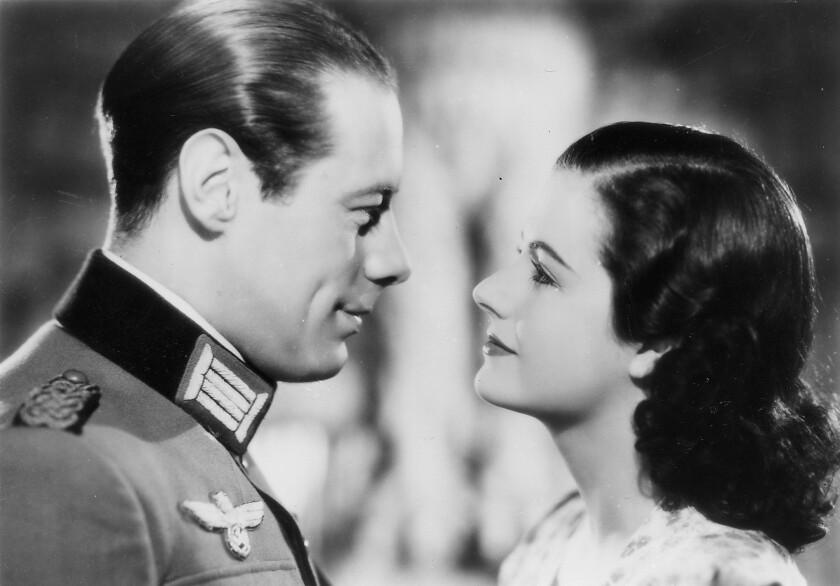 "Rex Harrison and Margaret Lockwood in ""Night Train to Munich."""