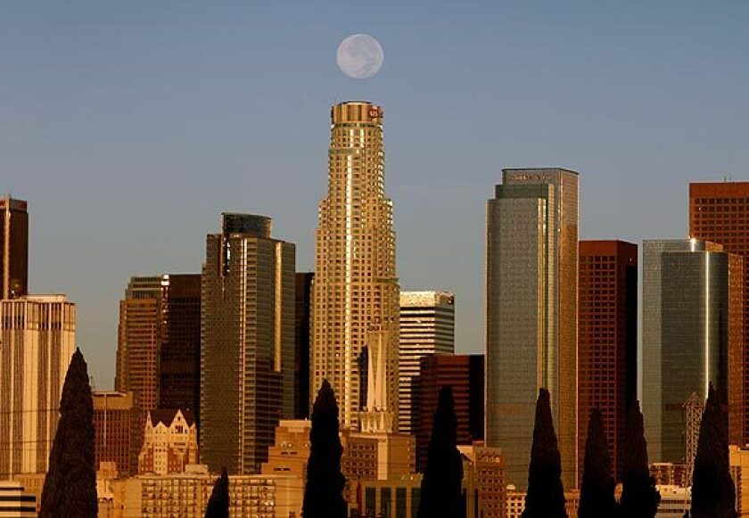 The downtown L.A. skyline on a 2008 day with a full moon directly above the U.S. Bank Tower.