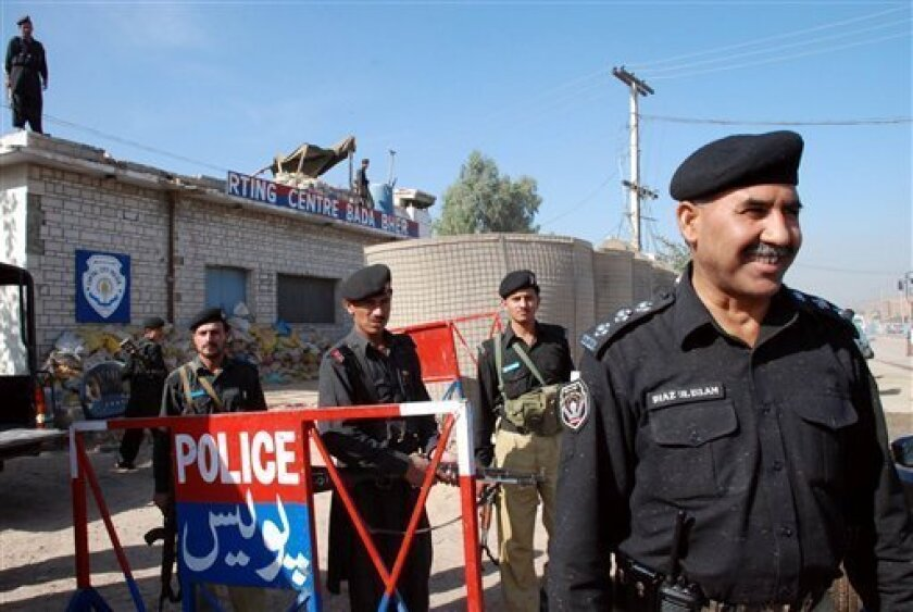 Pakistani police officers are seen outside the heavily guarded Badaber police station on the outskirts of Peshawar, Pakistan, Tuesday Nov 4, 2008. Officers left the police force a month ago, terrified of dying as their colleagues had - beheaded by militants on a rutted village road before a shocked crowd. (AP Photo/Mohammad Sajjad)