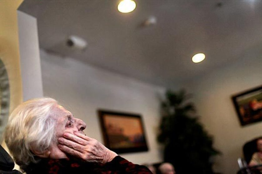 Pearl Cummings, 88, hangs out in the living room of a West Hollywood care home. See full story